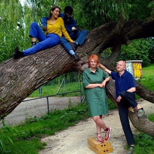 four hipsters sitting on a tree
